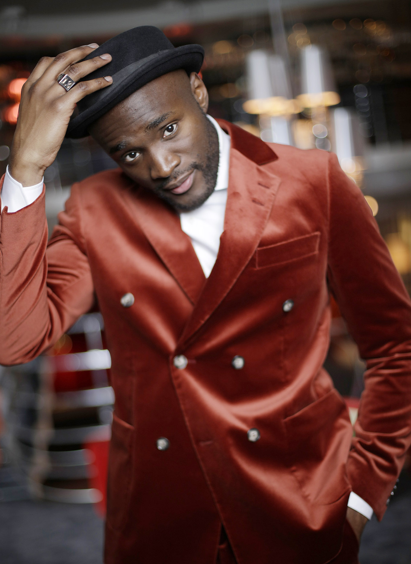 Boris René red suit